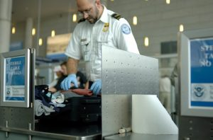 Alt tag not provided for image https://www.airfarewatchdog.com/blog/wp-content/uploads/sites/26/2014/02/tsa-agent_searching_bag-580x382-300x198.jpg