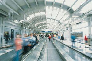 Alt tag not provided for image https://www.airfarewatchdog.com/blog/wp-content/uploads/sites/26/2015/05/airport-blurredtravelersonmovingwalkway-dd-300x200.jpg