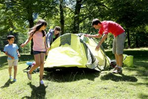Alt tag not provided for image https://www.airfarewatchdog.com/blog/wp-content/uploads/sites/26/2015/05/family-setting_up_tent-dd-300x200.jpg