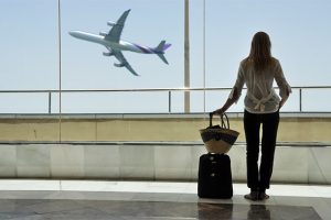 Alt tag not provided for image https://www.airfarewatchdog.com/blog/wp-content/uploads/sites/26/2015/06/airport-womanstandingwithcarryon-dd-300x200.jpg