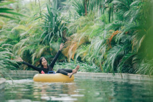 Woman floating down lazy river