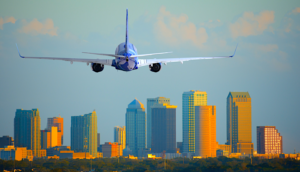 Airplane taking off with Tampa skyline in the background