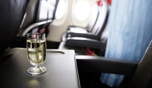 Alt tag not provided for image https://www.airfarewatchdog.com/blog/wp-content/uploads/sites/26/2018/03/airlinedrinkbooze-300x175.jpg