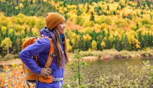 woman outdoors with backpack on a hike or walk in nature