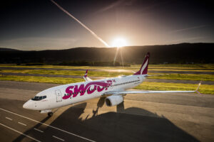swoop airlines airplane during sunset