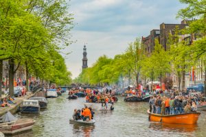 Alt tag not provided for image https://www.airfarewatchdog.com/blog/wp-content/uploads/sites/26/2019/03/Amsterdam-Canal-Kings-Day-Koningsday-Shutter-300x200.jpg