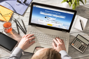 Person searching for flight on computer
