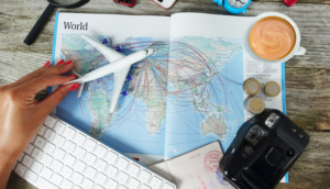 Woman with airplane toy over the world map