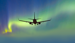 Airplane with the northern lights in the background