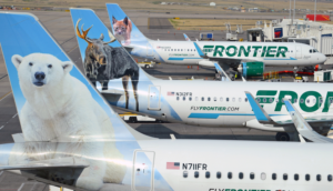 frontier airlines planes at gates with animal tails