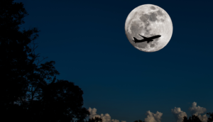 Airplane over full moon silhouette halloween