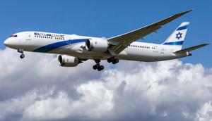 El Al 787 dreamliner in flight with clouds