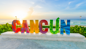Alt tag not provided for image https://www.airfarewatchdog.com/blog/wp-content/uploads/sites/26/2019/12/Cancun-mexico-sign-sunrise-yucatan-300x172.png
