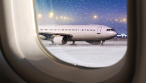 airplane on the tarmac with snow, winter travel
