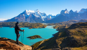 Hiker enjoying the view of Los Cuernos and Lake Pehoe in Torres del Paine National Park, Patagonia, Chile