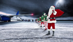 Santa Claus and Elves on tarmac boarding a flight for Christmas travel