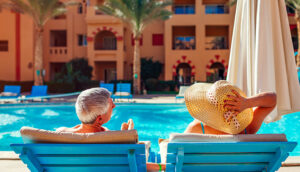 senior couple pool loungers hotel resort; Mariia Boiko/Shutterstock