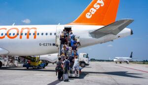 passengers boarding easyjet plane
