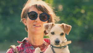 Woman with cool sunglasses and cute dog