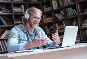 Man wears headphones for Zoom meeting