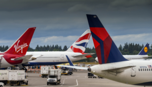 multiple airline tails on aircraft at seattle airport (delta, lufthansa, virgin, british)