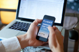 Person searching for flights on their phone