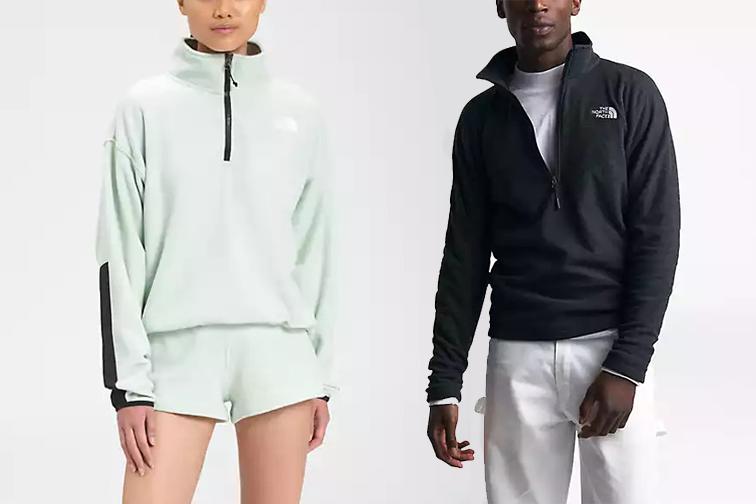 A man and a women wearing North Face fleece sweatshirts