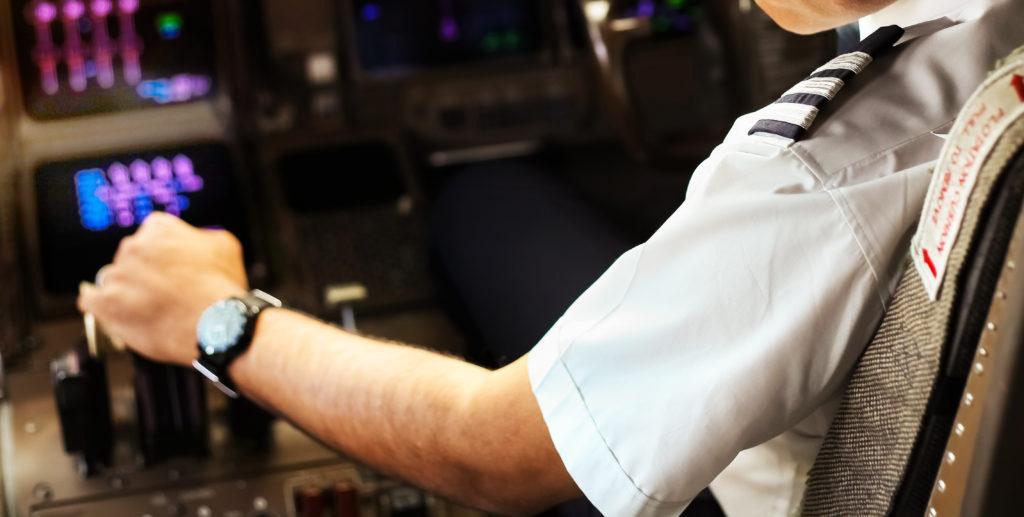 Pilot in airplane cockpit