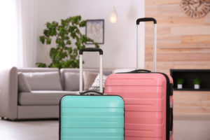 Pink and teal suitcases in living room