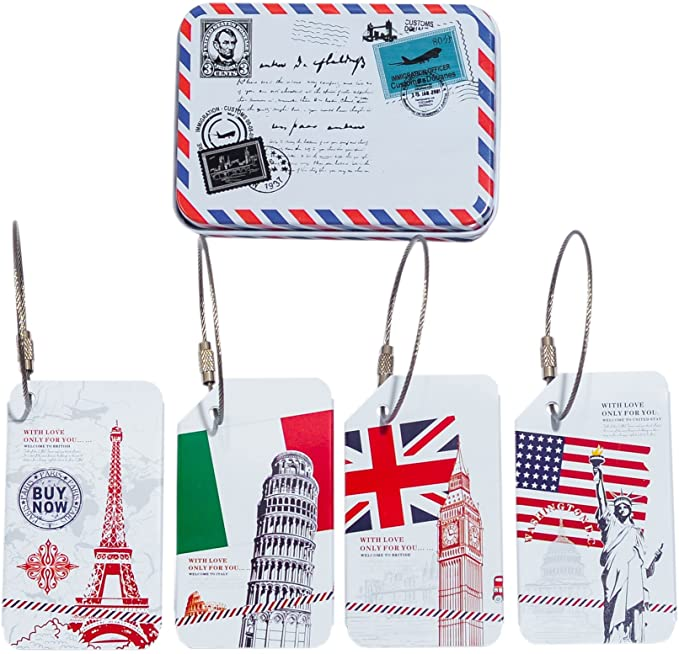 Four luggage tags and a metal container with imagery from Italy, France, England, and the United States