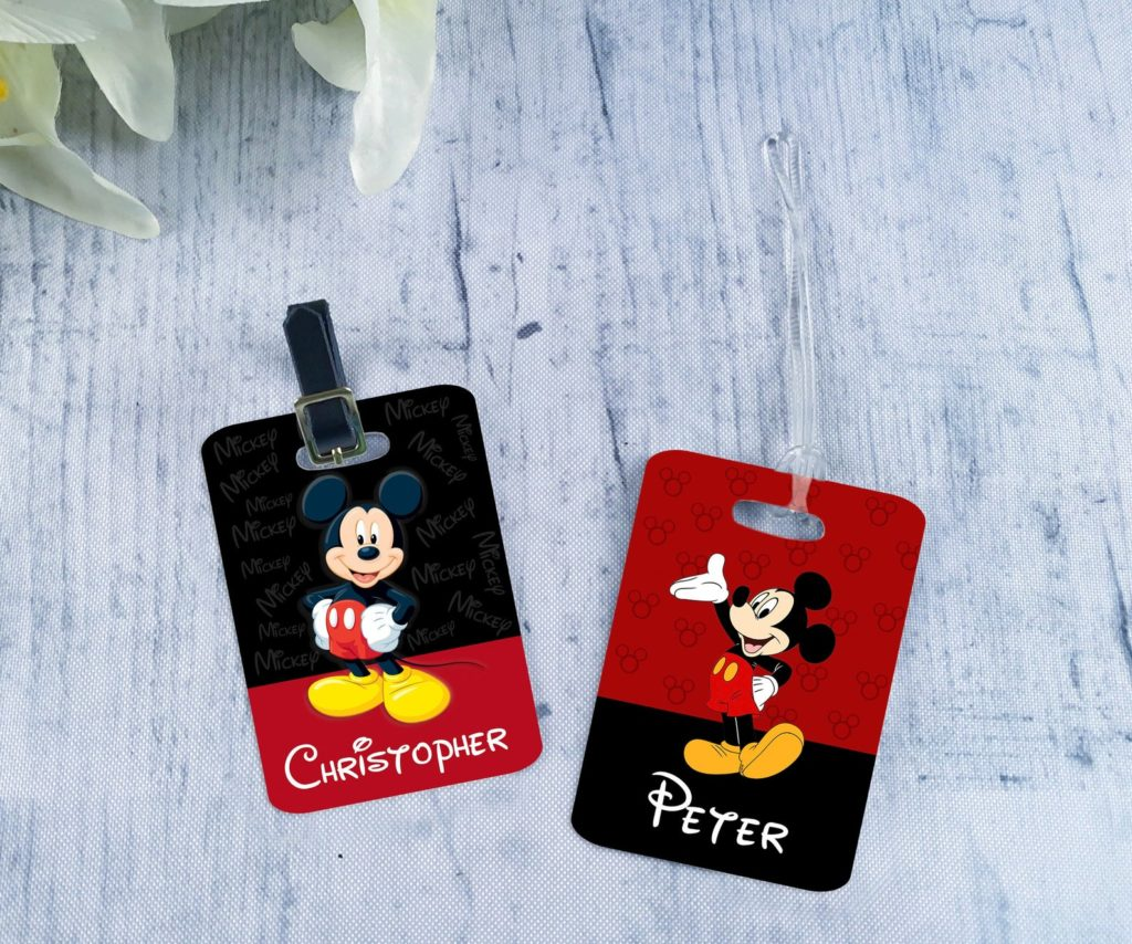 Two luggage tags with Mickey Mouse on them