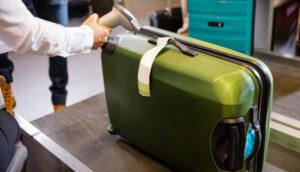 Alt tag not provided for image https://blog.airfarewatchdog.com/uploads/sites/26/2013/06/skycap-baggage-drop-300x172.jpg