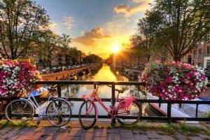 Alt tag not provided for image https://blog.airfarewatchdog.com/uploads/sites/26/2015/03/amsterdam-bicyclesonbridgesunrisespring-dd-300x200.jpg