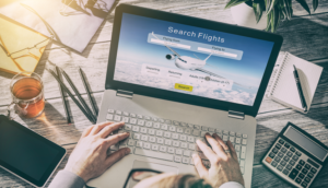 searching for flights on a laptop