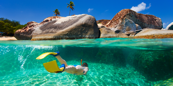 woman snorkeling at the Baths in the British Virgin Islands