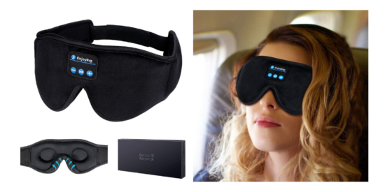 black eye mask with built in speaker, woman sitting on airplaine wearing black eye mask