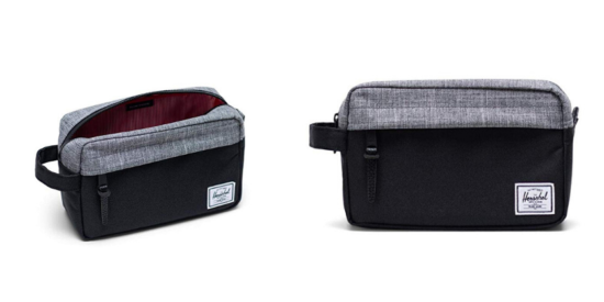 grey and black herschel toiletry bag, open with red inside