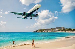 Alt tag not provided for image https://blog.airfarewatchdog.com/uploads/sites/26/2019/03/Caribbean-St-Maarten-Maho-Beach-Airplane-Shutter-300x196.jpg