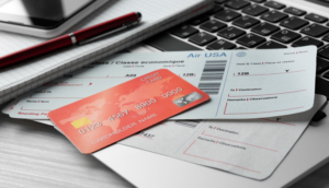 Airline Credit Card and tickets on a laptop