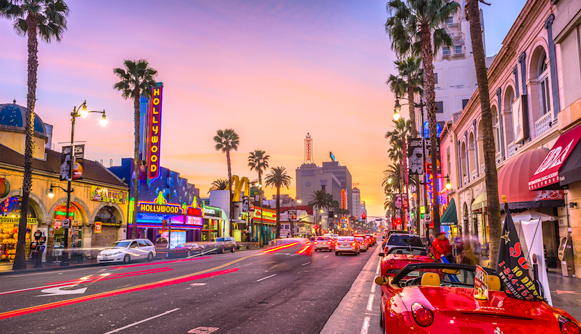 Hollywood Boulevard in Los Angeles at night with cars