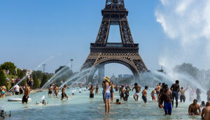 tourists and locals taking a bath in the Jardins du Trocad ro Guardians of the Trocadero under the powerful water cannons