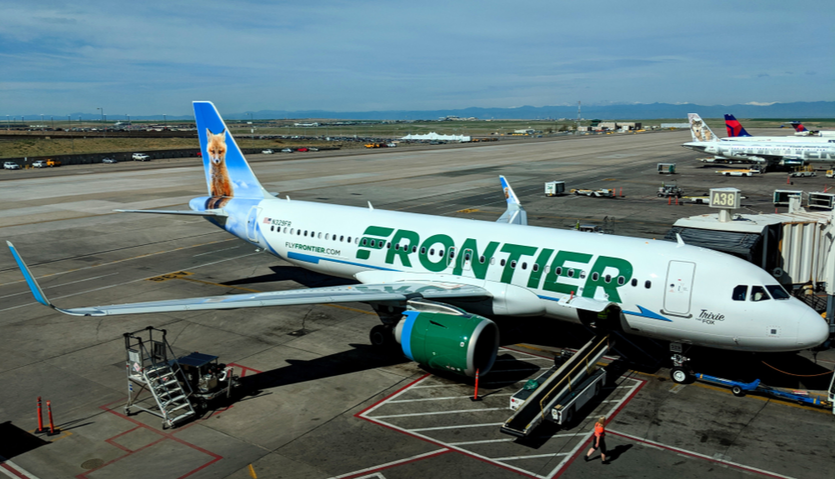 frontier airlines airplane at gate in denver