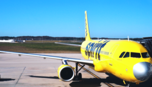spirit airlines yellow airplane with grey nose parked at gate in fort myers florida