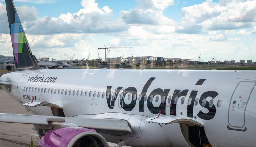 volaris airlplane at gate in orlando florida