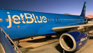 JetBlue airplane waiting on tarmac with all blue colorway