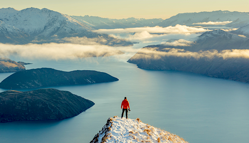 Man looking out over lake Wanaka near Queenstown New Zealand
