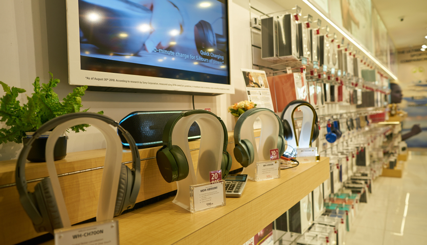 headphones and cellphone accessories on display in airport store