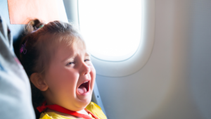 young child cries on an airplane