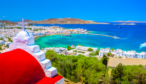 View of Mykonos harbor from hill with church