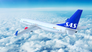 SAS Scandinavian airplane over clouds